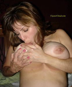 Milf sucks her own tits